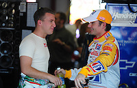 Apr 24, 2009; Talladega, AL, USA; NASCAR Sprint Cup Series driver Jeff Gordon (right) talks with A.J. Allmendinger during practice for the Aarons 499 at Talladega Superspeedway. Mandatory Credit: Mark J. Rebilas-