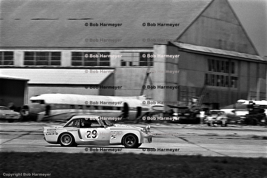 The Lotus Elan of Tato Ferrer, Manuel Godinez and Bonky Fernandez runs through the sweeping corner between the old Turns 1 and 2 - a section of the circuit that has been redesigned. The Lotus finished 58th in the 1977 race.