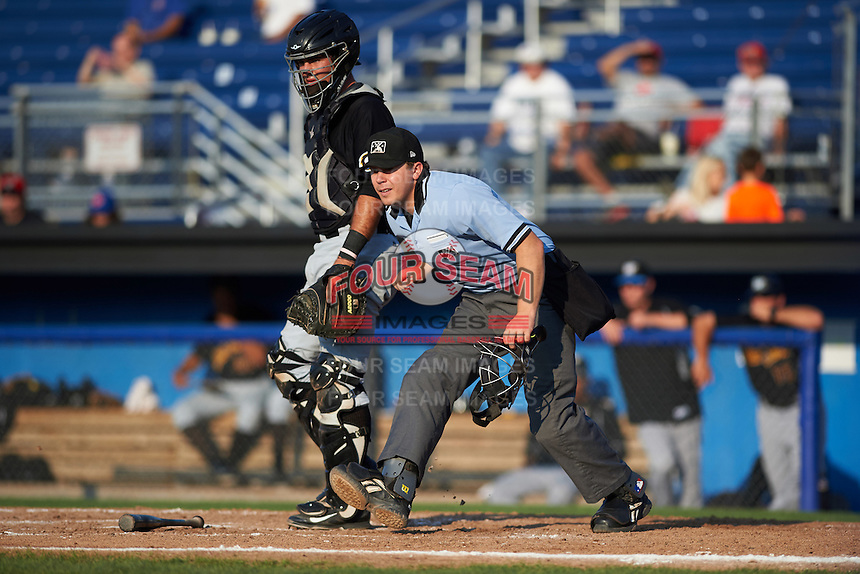 Umpire Matt Carlyon and catcher Daniel Arribas watch the ball during a game between the West Virginia Black Bears and Batavia Muckdogs on August 30, 2015 at Dwyer Stadium in Batavia, New York. Batavia defeated West Virginia 8-5. (Mike Janes/Four Seam Images)
