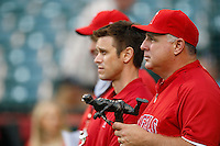 Los Angeles Angels Manager Mike Scioscia #14 and Angels General manager Jerry Dipoto before a game against the Chicago White Sox at Angel Stadium on September 22, 2012 in Anaheim, California. Los Angeles defeated Chicago 4-2. (Larry Goren/Four Seam Images)