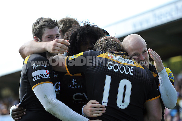 Ashley Johnson celebrates with his team-mates after scoring a try. European Champions Cup play-off, between London Wasps and Stade Francais on May 18, 2014 at Adams Park in High Wycombe, England. Photo by: Patrick Khachfe / JMP