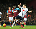 West Ham's Emmanuel Emenike tussles with Tottenham's Ben Davies<br /> <br /> - English Premier League - West Ham Utd vs Tottenham  Hotspur - Upton Park Stadium - London - England - 2nd March 2016 - Pic David Klein/Sportimage