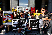 Kurdish hunger strikers outside the United Nations University in Omote Sando, Tokyo, Japan. Friday November 9th 2012. The strike lasted from 8am to 8pm to show solidarity with nearly 800 Kurdish political prisoners held in Turkey who have been on hunger strike for 2 months