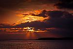 Sunset rays over Gulf of Alaska near Yakutat, Southeast Alaska.