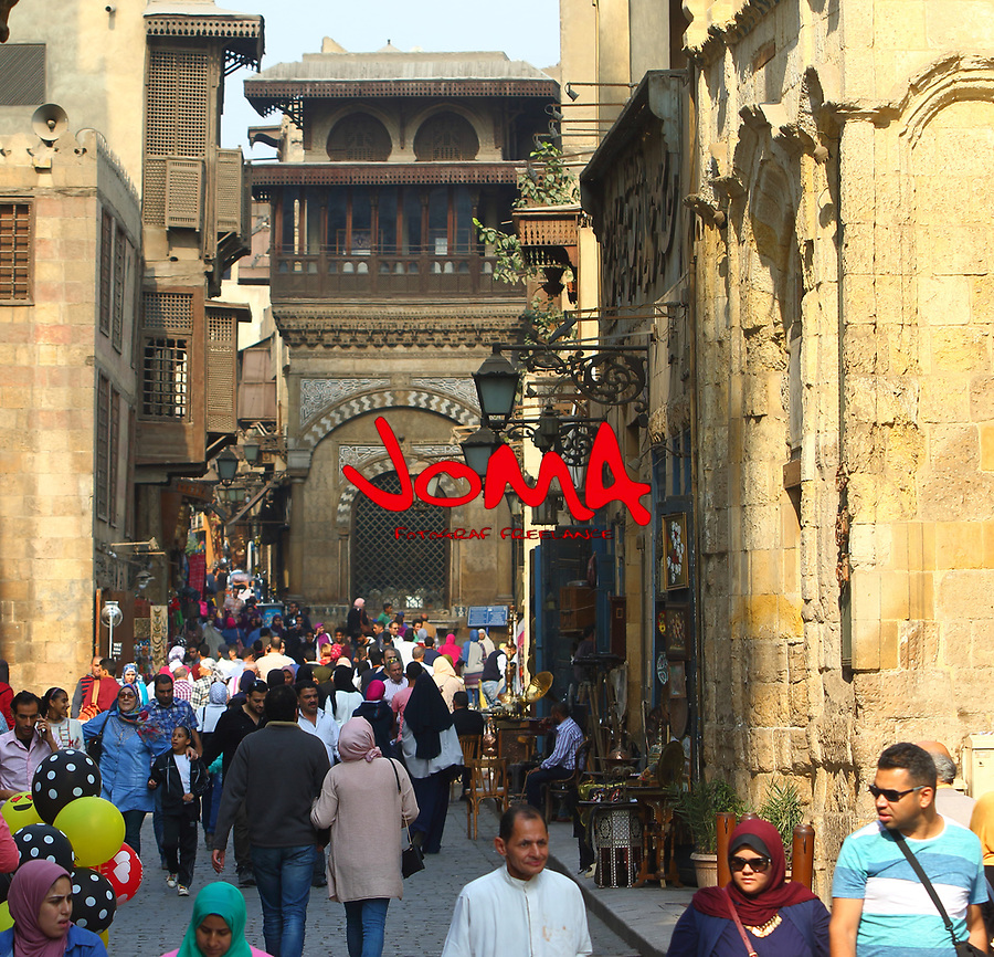 The Al Moez L din Allah Al Fatmi Street full of people passing in front of the Sabil-kuttab of Abdel Rahman Katkhuda