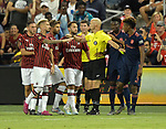 Referee Allen Chapman holds Bayern Munich and Milan players apart after tempers flared during their International Champions Cup match on July 23, 2019 at Children's Mercy Park in Kansas City, KS.<br /> Tim VIZER/AFP