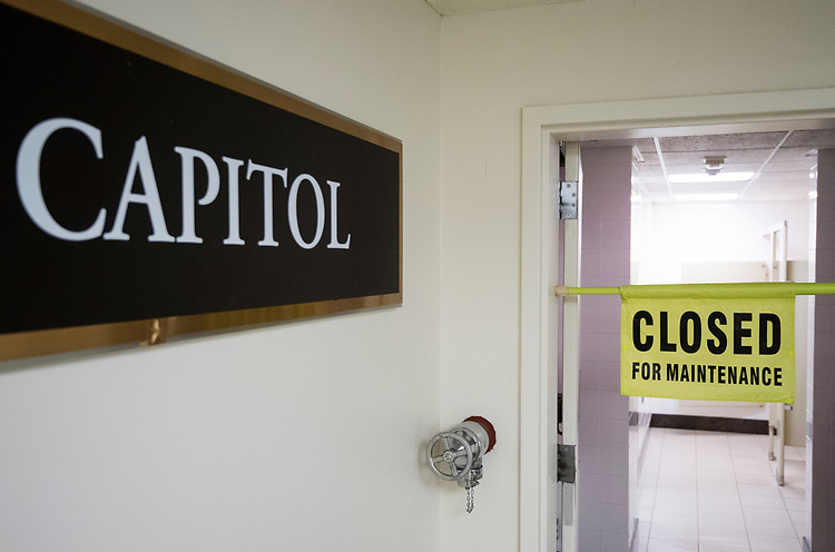 """UNITED STATES - AUGUST 7: A temporary """"closed for maintenance"""" sign hangs in the doorway to the women's restroom by the Senate subway entrance to the Capitol during recess on Tuesday, Aug. 7, 2018. (Photo By Bill Clark/CQ Roll Call)"""
