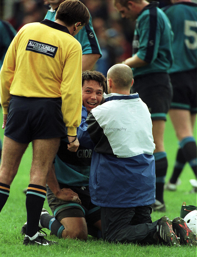 Richard Lane Photography .Photo. Richard Lane. Bath v Bedford. 2/10/98. Rory Underwood is able to smile after taking a blow to the head.