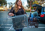 Susan Smith of Rivertown Cats and H.A.R.P. (Homeless Animal Response Program) carries a recebtkt trapped cat in Antioch, California on Saturday, March 22, 2014.  The cat will be taken to a clinic to be spayed/neutered and vaccinated and then will be returned to its' outside home area.  Photo/Victoria Sheridan