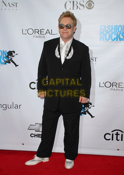 SIR ELRON JOHN.Conde Nast Media Group's Third Annual Fashion Rocks Concert at Radio City Music Hall, New York, NY, USA,.7 September 2006..full length sunglasses wings black suit.Ref: ADM/PH.www.capitalpictures.com.sales@capitalpictures.com.©Paul Hawthorne/AdMedia/Capital Pictures. *** Local Caption ***