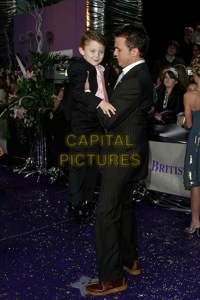 SAM O'BRIEN & DARREN JEFFRIES.Arrivals at The British Soap Awards 2006, .BBC Television Centre, Wood Lane, .London, England, May 20th, 2006..full length picking up holding little boy.Ref: AH.www.capitalpictures.com.sales@capitalpictures.com.©Adam Houghton/Capital Pictures..