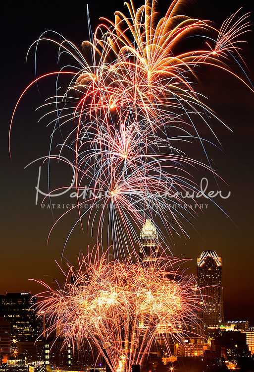 Fireworks to celebrate America's Independence Day (The Fourth of July) light up the Charlotte, NC, skyline on July 4, 2010. Buildings shown in the background include the new Duke Energy Center tower (far left), One Wachovia Center, the Hearst Tower (far right), and Bank of America Corporate Center (tallest).