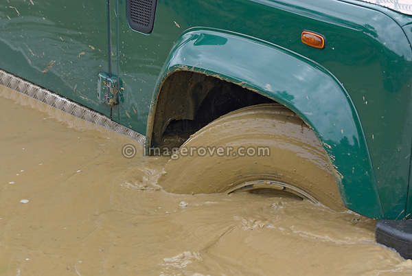 Land Rover driving off road through a flooded road in Bining, France. --- No releases available. Automotive trademarks are the property of the trademark holder, authorization may be needed for some uses.