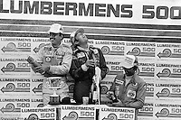 LEXINGTON, OH - AUGUST 26: Bobby Rahal (left), Brian Redman (center) and Tony Cicale (right) celebrate their victory in the 1979 Lumbermens 6 Hours race on August 26, 1979, at Mid-Ohio Sports Car Course near Lexington, Ohio.