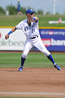Paul Janish #21 of the Omaha Storm Chasers throws to first base against the Las Vegas 51s at Werner Park on August 17, 2014 in Omaha, Nebraska. The Storm Chasers  won 4-0.   (Dennis Hubbard/Four Seam Images)