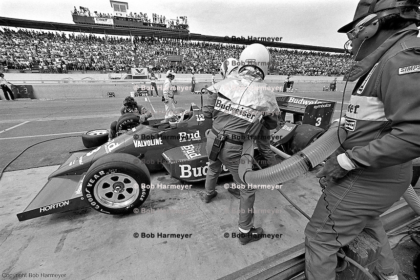 Bobby Rahal makes a pit stop in the Budweiser-sponsored Truesports March 86C Cosworth during the 1986 CART IndyCar race at Phoenix International Raceway near Phoenix, Arizona.