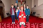 Pupils from Scoil Naomh Eirc Séamus Mac Gearailt, Coimhe Ní Bheghlaoich and Malachaí Ó Ciardhubhain, pictured with their muinteoir Fearghal Ó Sé, príomhoide Aine De Londra and an t-Easpag Réamonn De Brún, on the day of their Confirmation at Séipéal na Carraige on Wednesday afternoon.