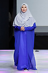 Mayalsian fashion designer Eja Shahril poses on runway with models at the close her Eja Shahril collection fashion show for Couture Fashion Week Spring 2018 at the Crowne Plaza Times Square in Manhattan, on September 8, 2017; during New York Fashion Week.