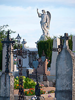 France, FRA, Beaujolais, Fleurie, 2010Aug15: An angel above the graves on the Fleurie graveyard.