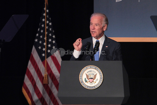 New York, NY-July 27:  United States Vice-President Joe Biden attends the announcement of the unveiling of the vision for the comprehensive redesign of LaGuardia Airport held by New York State Governor Mario Cuomo held during the Annual Association For a Better New York Luncheon on July 27, 2015 in Bronx, New York City.  Photo Credit:  Terrence Jennings / MediaPunch