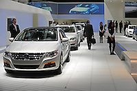 A man walks across the Volkswagon showroom at the Detroit Auto Show in Detroit, Michigan on January 12, 2009.
