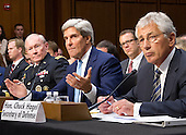 """United States Secretary of Defense Chuck Hagel, right, U.S. Secretary of State John Kerry, center, and General Martin Dempsey, Chairman of the Joint Chiefs of Staff, left, testify before the U.S. Senate Foreign Relations Committee on """"Authorization of Use of Force in Syria""""  on Capitol Hill in Washington, D.C. on Tuesday, September 3, 2013.<br /> Credit: Ron Sachs / CNP"""
