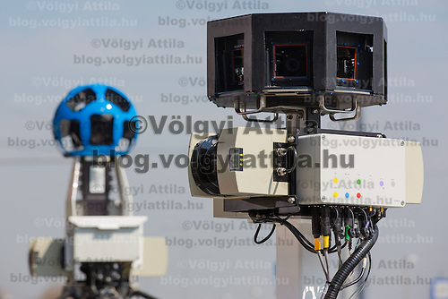 Camera section of the special car (L) and trike (R) recording photos for the Google Street View service during a press conference on the Hungarian launch of Google Street View in Budapest, Hungary on April 23, 2013. ATTILA VOLGYI