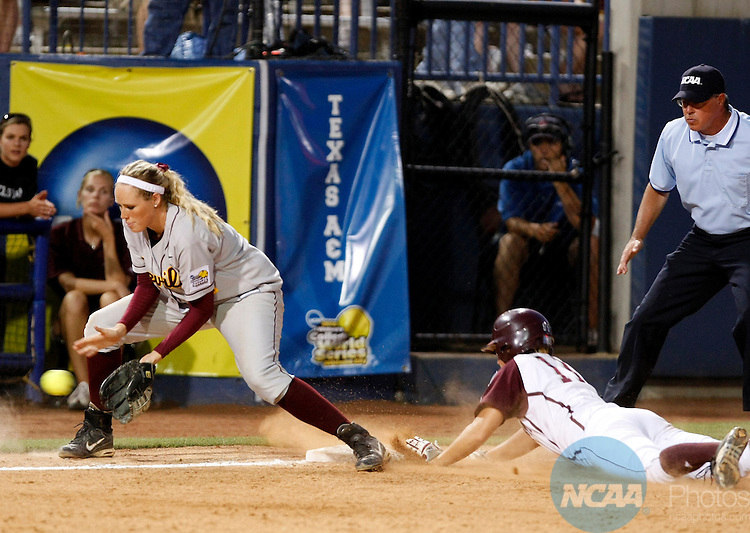 03 JUNE 2008: Arizona State's Mandy Urfer (11) tries to make a play against  Texas A&M's Megan Gibson (11) at third base during the Division I Women's Softball Championship at ASA Hall of Fame Stadium in Oklahoma City, OK.  Arizona State defeated Texas A&M 11-0 in Game Two to win the national title.  Stephen Pingry/NCAA Photos