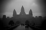 Visitors brave a tropical storm as they walk through the grounds of the main temple in the Angkor Wat temple complex in Siem Reap, Cambodia..Photographer: Robert Gilhooly