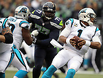 Carolina Panthers  quarterback Kam Newton (1) scrambles away from the Seattle Seahawks at CenturyLink Field in Seattle on October 18, 2015. The Panthers came from behind with 32 seconds remaining in the 4th Quarter to beat the Seahawks 27-23.  ©2015 Jim Bryant Photography. All Rights Reserved.