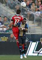 CHESTER, PA - AUGUST 12, 2012:  Freddy Adu (11) of the Philadelphia Union is beaten to a header by  Gonzalo Segares (13) of the Chicago Fire during an MLS match at PPL Park, in Chester, PA on August 12. Fire won 3-1.