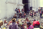 People praying outside Santo Tomas church, Chichicastenango, Guatemala