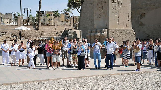 Egyptian President Mohamed Morsi speaks with a group of foreign tourists during his visit to Luxor, Upper Egypt, 03 August 2012. Morsi on 03 August visited Luxor and Karnak temples in Luxor, one day after he swore in a new cabinet. The new Prime Minsiter Hisham Qandil told reporters on 02 August that revitalizing the national economy and bringing security back to the country's streets would be his government's priorities. Photo by EGYPTIAN PRESIDENCY