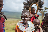 TANZANIA,  a portrait of Maasai Kid in Ngorongoro Conservation Area, other kids in the background