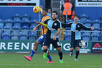 Wycombe Wanderers Sam Wood wins the ball from Mansfield Town's Reggie Lambe during the Sky Bet League 2 match between Mansfield Town and Wycombe Wanderers at the One Call Stadium, Mansfield, England on 31 October 2015. Photo by Garry Griffiths.