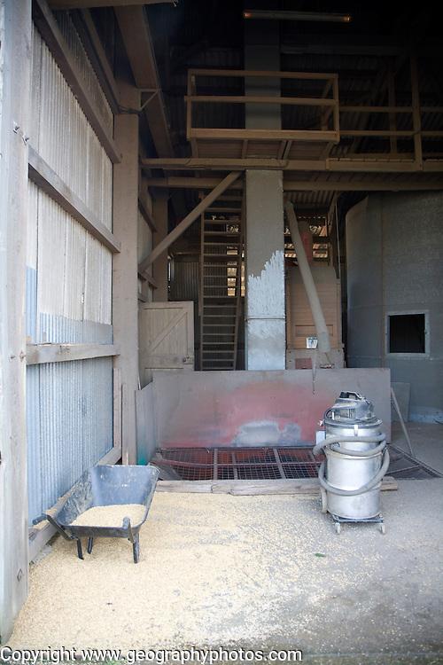 Grain processing in farm building Sutton, Suffolk, England