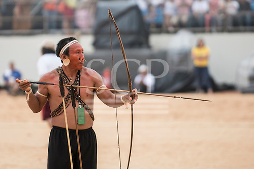 A Matis contestant prepares for the archery competition at the International Indigenous Games, in the city of Palmas, Tocantins State, Brazil. Photo © Sue Cunningham, pictures@scphotographic.com 25th October 2015