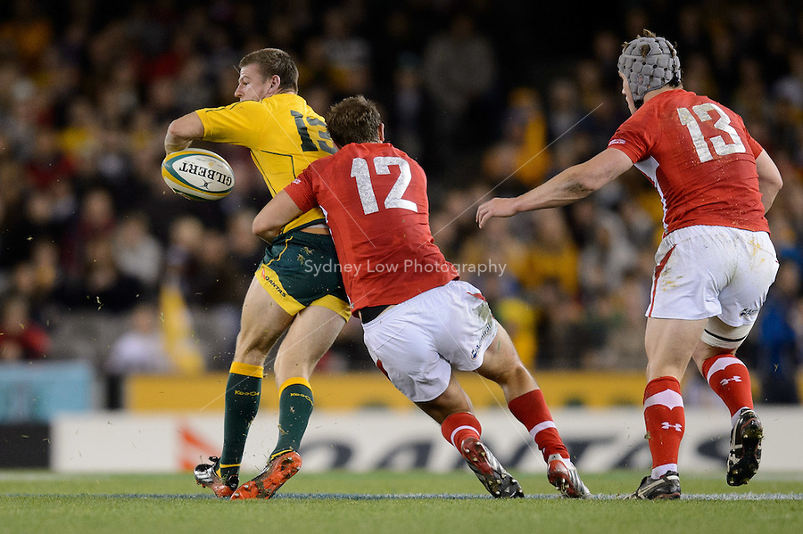 MELBOURNE, AUSTRALIA - JUNE 16: Rob Horne of the Wallabies passes the ball during the 2nd match of the Castrol Edge Rugby series between the Australian Wallabies and Wales at Etihad Stadium. (Photo Sydney Low / sydlow.com)..Contact zumapress.com for editorial licensing.
