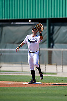 GCL Marlins first baseman Zachary Owings (20) stretches for a throw during a Gulf Coast League game against the GCL Astros on August 8, 2019 at the Roger Dean Chevrolet Stadium Complex in Jupiter, Florida.  GCL Astros defeated GCL Marlins 4-2.  (Mike Janes/Four Seam Images)