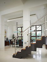 Architectural inspired floated stairs and custom designed lighting