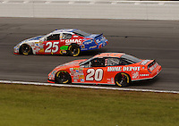 June 11, 2006; Long Pond, PA, USA; Nascar Nextel Cup driver Brian Vickers (25) races Tony Stewart (20) during the Pocono 500 at Pocono Raceway. Mandatory Credit: Mark J. Rebilas