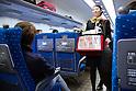 Osaka, JP - January 21, 2015 : A female coffee vender serves passengers on the Shinkansen bullet train traveling to Osaka from Tokyo. (Photo by Rodrigo Reyes Marin/AFLO)