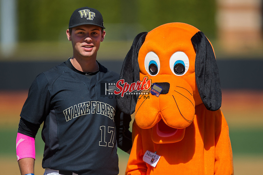"Bruce Steel (17) of the Wake Forest Demon Deacons poses with ""Rover"" following the ceremonial first pitch on ""Bark in the Park"" day prior to the game against the Florida State Seminoles at David F. Couch Ballpark on April 16, 2016 in Winston-Salem, North Carolina.  The Seminoles defeated the Demon Deacons 13-8.  (Brian Westerholt/Sports On Film)"