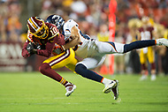 Landover, MD - August 24, 2018: Washington Redskins wide receiver Paul Richardson (10) is tackled by Denver Broncos defensive back Justin Simmons (31) during preseason game between the Denver Broncos and Washington Redskins at FedEx Field in Landover, MD. The Broncos defeat the Redskins 29-17. (Photo by Phillip Peters/Media Images International)