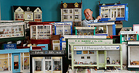 BNPS.co.uk (01202 558833)<br /> Pic: ZacharyCulpin/BNPS<br /> <br /> PICTURED: Volunteer Penri Jones sorts through the stunning array of 1950's shop fronts that are set for a winter clean up. Wimborne Model Town is a 1/10th scale of the centre of Wimborne as it was in the 1950s.  <br /> <br /> A popular model village is being given an extensive winter clean in a bid to spruce it up ready for summer trade.<br /> <br /> The Wimborne Model Town in Dorset is currently undergoing extensive work ready for tourists to return next year.<br /> <br /> The scaled down buildings have all had their windows removed and will be painted in the coming months.<br /> <br /> The work is carried out by a team of volunteers, who often find themselves in uncompromising positions to reach the various nooks and crannies.<br /> <br /> While cleaning, the team have been known to fully squeeze into the models in order to do a full and proper job.<br /> <br /> The village is set to reopen in March 2020.