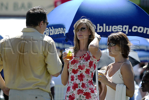 7 August 2004: Racegoers enjoying a drink in the Paddock before racing on The Blue Square Shergar Cup day at Ascot. Photo: Neil Tingle/action plus...horse racing 040807 crowd