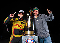 Nov 11, 2018; Pomona, CA, USA; NHRA funny car driver J.R. Todd (left) and photographer Mark Rebilas poses for a portrait with the championship trophy during the Auto Club Finals at Auto Club Raceway. Mandatory Credit: Jason Zindroski-USA TODAY Sports