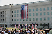 United States President Barack Obama, Defense Secretary Chuck Hagel and Chairman of the Joint Chiefs of Staff General Martin Dempsey observe a moment during the  12th anniversary commemoration of the 9/11 terrorist attacks at the Pentagon Memorial at the Pentagon in Washington, DC on September 11, 2013. Nearly 3,000 people were killed in the attacks in New York, Washington and Shanksville, Pennsylvania.   <br /> Credit: Pat Benic / Pool via CNP