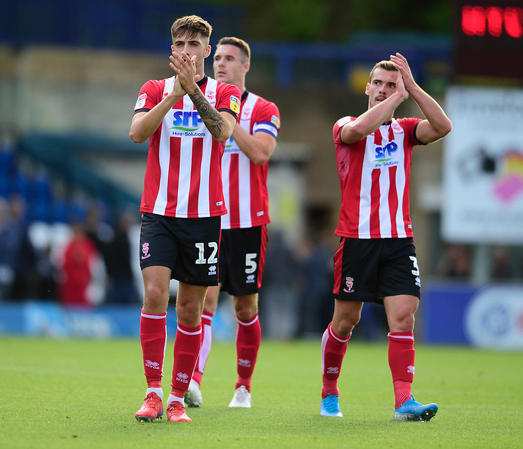Lincoln City's Ellis Chapman, left, Jason Shackell and Harry Toffolo applauds the fans at the final whistle<br /> <br /> Photographer Andrew Vaughan/CameraSport<br /> <br /> The EFL Sky Bet League One - Wycombe Wanderers v Lincoln City - Saturday 7th September 2019 - Adams Park - Wycombe<br /> <br /> World Copyright © 2019 CameraSport. All rights reserved. 43 Linden Ave. Countesthorpe. Leicester. England. LE8 5PG - Tel: +44 (0) 116 277 4147 - admin@camerasport.com - www.camerasport.com