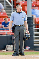Home plate umpire Tim Rosso between innings of the South Atlantic League game between the Rome Braves and the Hickory Crawdads at  L.P. Frans Stadium May 23, 2010, in Hickory, North Carolina.  The Rome Braves defeated the Hickory Crawdads 5-1.  Photo by Brian Westerholt / Four Seam Images